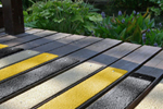 Anti-slip GRP decking strips available in yellow black sand