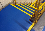 Anti-slip paint coating to steel steps in a factory - applied by SureStep
