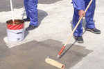 Roller applied surface DPM to concrete floor