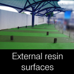 External surface coloured and non-slip resin coatings