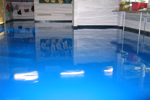 Blue gloss finish resin floor coating in school classroom