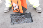 Permanent cold-applied pothole repairs in tarmac