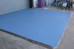 UV stable slip-resistant seamless resin coating for outdoor animal enclosures and pens