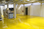Bright yellow flow applied self-smoothing epoxy screed with glassy gloss finish