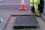 Bedding ironwork in roads / highways / motorways