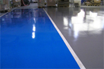 Resin floor with coloured demarcation zones and line markings