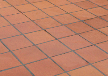 Traditional terracotta floor tiles in school kitchen